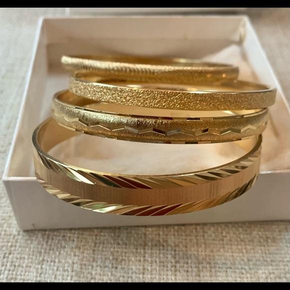Monet vintage gold bangles